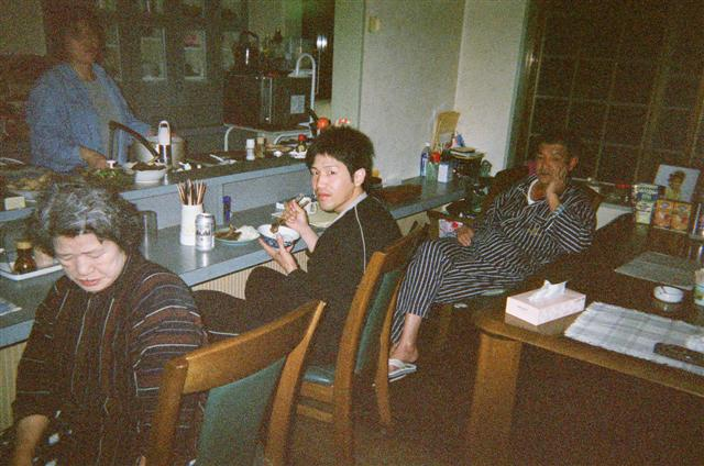 Masko, Shingo, and Hede. Sumiko in the kitchen.